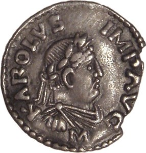 A coin of Charlemagne with the inscription KAROLVS IMP AVG (Karolus Imperator Augustus) from Wikipedia